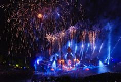 Electronic Fireworks. Fireworks exploding over a big electronic music festival Stock Image