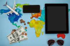 Electronic gadgets, sunglasses, dollar and airplane model Stock Photo