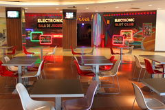 Electronic games. Local electronic games in Plaza Romania. Tables and chairs with modern design Stock Image