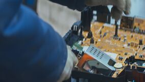 Electronic garbage disassemble for recycling at a plant.