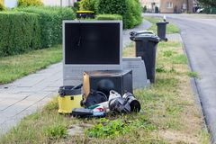 Electronic garbage on the roadside. Electronic garbage with a television, vacuum cleaner and other electrical appliances on the roadside royalty free stock photography
