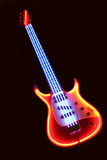 Electronic guitar. Advertising model of  electronic guitar with neon illumination on  black background Stock Photos