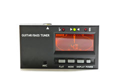 Electronic guitar and bass tuner Royalty Free Stock Photos