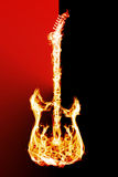 Fire electric guitar. Electronic guitar flames on a black background Royalty Free Stock Image