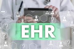 Electronic health record. EHR on the touch screen with medicine icons on the background blur Doctor in hospital royalty free stock image