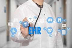 Electronic health record. EHR on the touch screen with medicine Stock Images