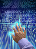 Electronic identification scan. Male hand over electronic circuit and touchpad, identification scanning data processed into binary code stock photo