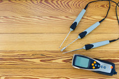 Electronic instrument for measuring of temperature probes on wood background Stock Image