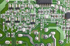 Electronic integrated circuitry macro detail. Technology backgro Stock Images