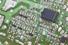 Electronic integrated circuitry macro detail. Technology backgro Royalty Free Stock Images