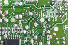 Electronic integrated circuitry macro detail. Technology backgro Stock Photography