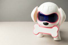 Electronic interactive toy dog puppy on a gray background, high technology concept, pet of the future, electronic home, copy space stock image