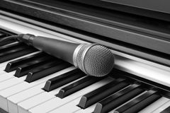 Electronic keyboard and microphone Stock Photo
