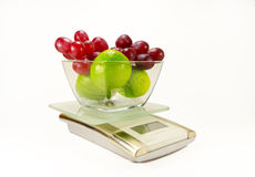 Electronic kitchen scales with fruit Stock Photography