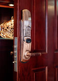 Electronic lock. Deluxe room red wood door with electronic lock Stock Images