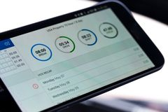 Free Electronic Logging Device For Trucking Industry With Hours Of Service Displayed On Smartphone Screen Stock Photos - 127335113