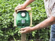Electronic machine placed in front of a garden to scare away frighten not only birds but wild animals. France royalty free stock images