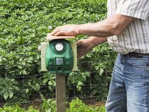 Electronic machine placed in front of a garden to scare away frighten not only birds but wild animals. France royalty free stock photos