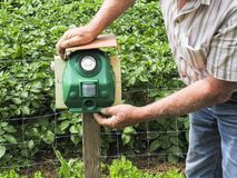Electronic machine placed in front of a garden to scare away frighten not only birds but wild animals. France stock image