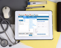 Electronic medical record show on tablet. Stock Photos