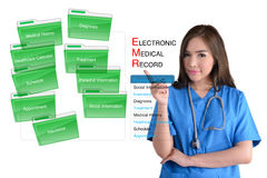 Electronic medical record system. Electronic medical record system and female doctor in blue uniform on white background Royalty Free Stock Photo