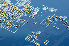 Electronic microchip circuit board. Close-up of electronic microchip circuit board with processor  background Royalty Free Stock Photos