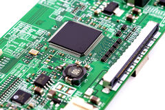 Electronic microchip circuit board. Electronic circuit and component background Royalty Free Stock Photography