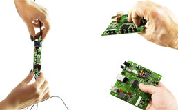 Electronic microcircuit in the hands of different angles Stock Image