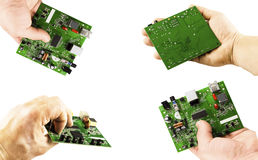 Electronic microcircuit in the hands of different angles Stock Photos