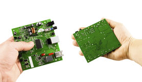 Electronic microcircuit in the hands of different angles Royalty Free Stock Image