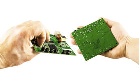 Electronic microcircuit in the hands of different angles Stock Images