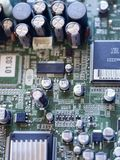 Electronic microcircuit with microchips and capacitors taken closeup Stock Photo