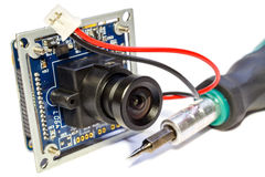 Electronic module with lens for surveillance camera and screwdriver on a white background Stock Photos