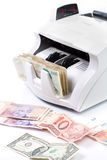 Electronic money counter. An electronic money counter processing bills Royalty Free Stock Images