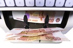 Electronic money counter machine is counting the Russian five-thousandth ruble banknotes.  Stock Photography