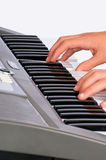 Electronic music keyboard. Playing an electronic music keyboard by a young man stock photos