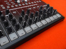 Electronic musical instrument or audio mixer or sound equalizer on a orange background analog modular synthesizer Stock Image