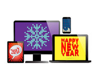 Electronic new year set. New Year 2017. Monitor PC computer, laptop, smartphone and tablet with various screen savers. Vector illustration Stock Image