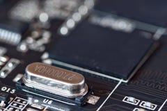 Electronic oscillator circuit on motherboard Stock Image