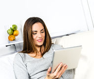 Electronic pad woman Royalty Free Stock Images