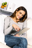 Electronic pad woman Royalty Free Stock Photos