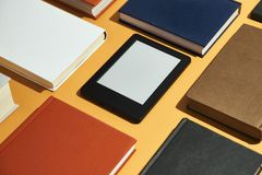 Electronic and paper books stock image