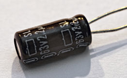 Electronic part capacitor. Near view of the electronic part capacitor Royalty Free Stock Photo