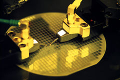 Electronic part production. Under yellow light Stock Photo