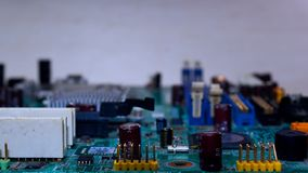 Electronic parts on a green PCB stock photo