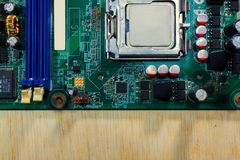 Electronic parts on a green PCB on wood, and copy space royalty free stock photos