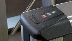 Electronic pass to turnstile wicket checkpoint in office. Modern equipment of access system in business center closeup. Macro video. Successful employees are stock video footage