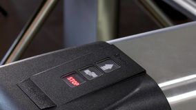 Electronic pass to turnstile wicket checkpoint in office. Modern equipment of access system in business center closeup. Macro video. Successful employees are stock video