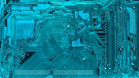 Electronic paths on the motherboard in turquoise. High technology, computer element stock images