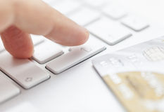Electronic payment, transaction. Man is entering credit card information to computer Royalty Free Stock Photo
